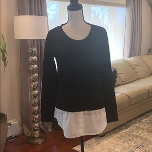 Black sweater with white formal shirt underneath